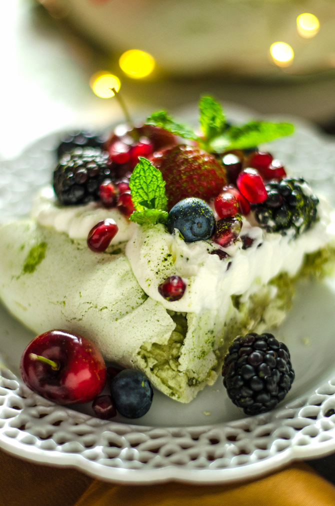 Matcha Christmas Wreath Pavlova. This sweet, smooth, and earthy-flavored dessert features a crisp crust and soft, marshmallowy center. Topped with whipped cream and berries, it makes a beautiful addition to your holiday table. | hostthetoast.com