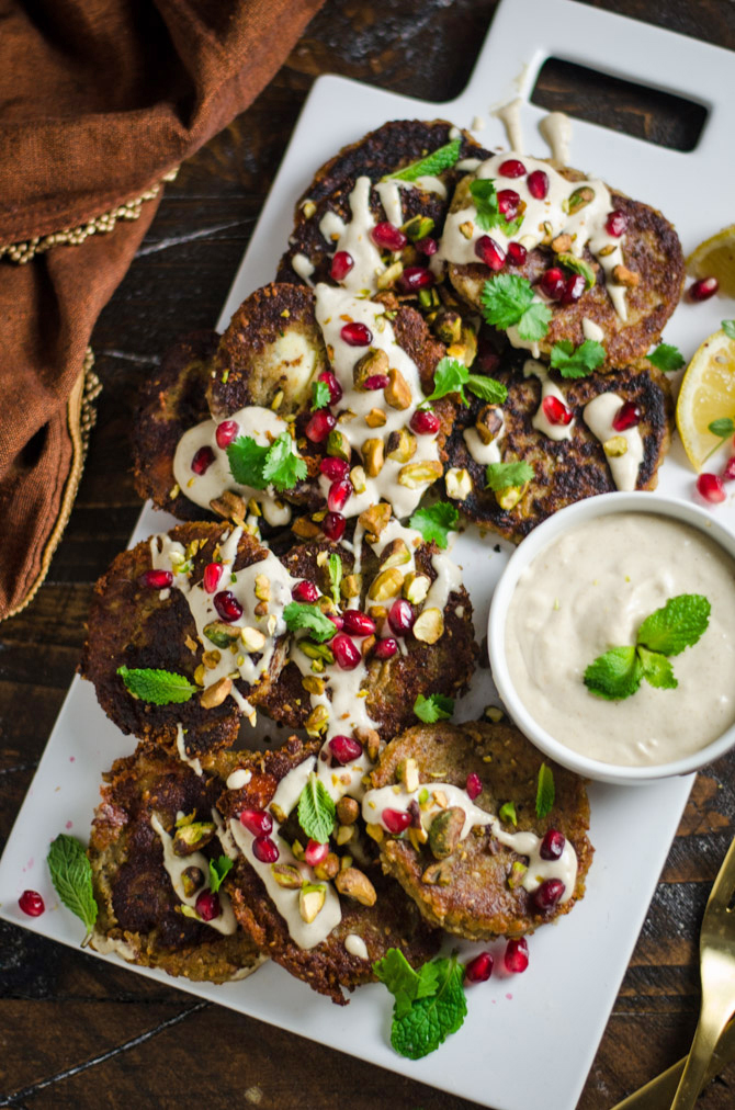 Roasted Eggplant and Feta Fritters with Tahini Sauce. These creamy-on-the-inside, crispy-on-the-outside appetizers will be a real treat to every eggplant lover! | hostthetoast.com