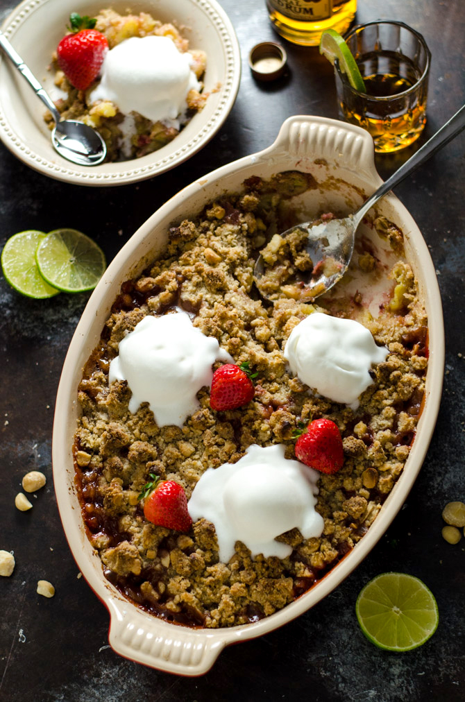 Rum-Caramelized Banana Berry Nut Crumble. This tropical-tasting dessert is incredibly easy to toss together, and is packed with flavor. It's the perfect balance of gooey filling and crisp topping! | hostthetoast.com