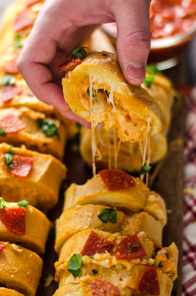 Pepperoni Pizza Stuffed Garlic Bread. A cheesy, tomato-sauce spiked dip gets packed inside of buttery bread for an easy-to-make, crowd-pleasing Super Bowl appetizer. | hostthetoast.com