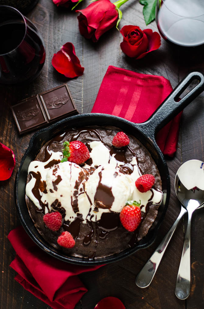 Skillet Red Wine Brownie. This fudgy brownie is spiked with red wine and topped with ice cream and red wine hot fudge! It's sinfully delicious but super easy to make for a date night or Valentine's Day!   hostthetoast.com