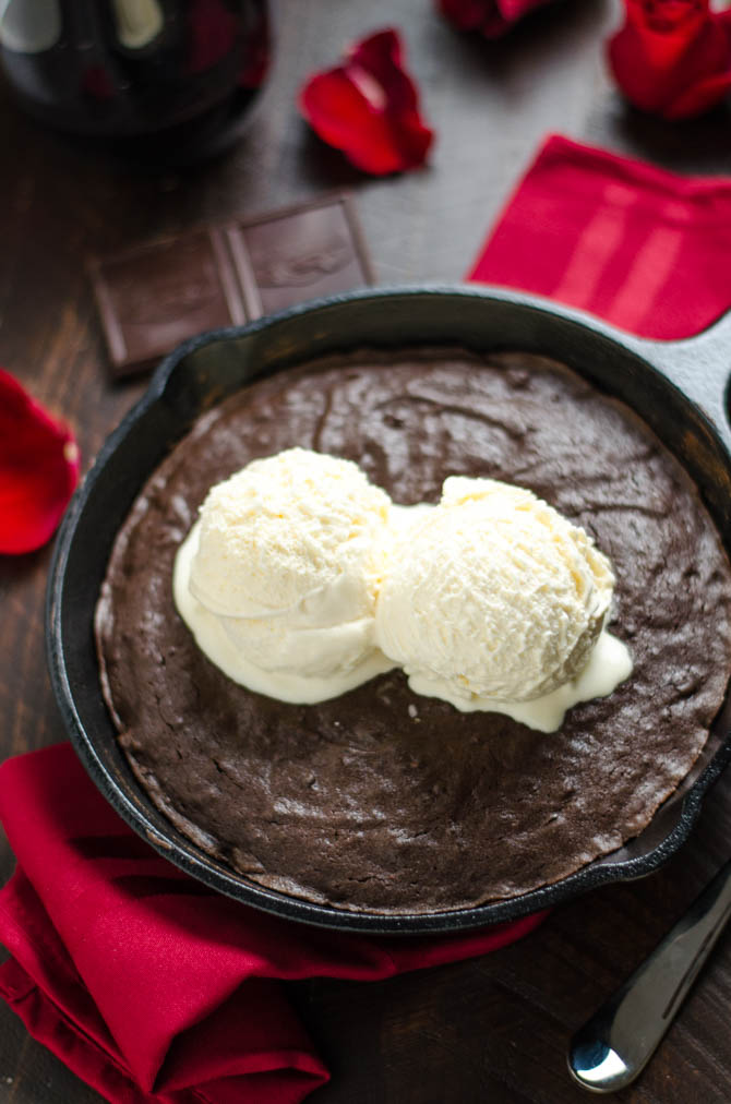 Skillet Red Wine Brownie. This fudgy brownie is spiked with red wine and topped with ice cream and red wine hot fudge! It's sinfully delicious but super easy to make for a date night or Valentine's Day! | hostthetoast.com