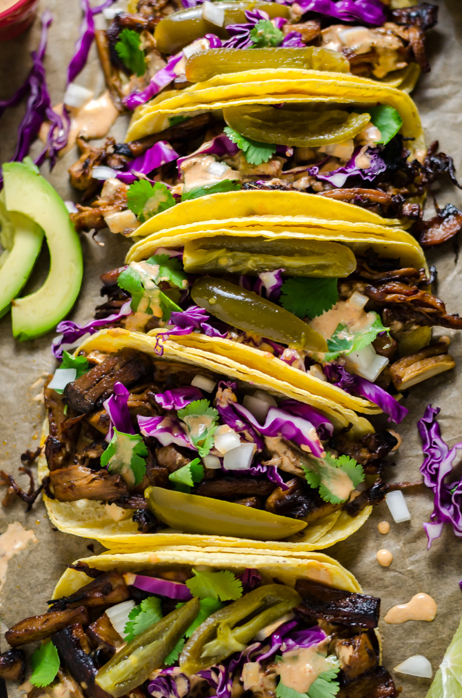 Mushroom Carnitas Tacos. These meatless tacos feature crisp, flavorful mushrooms for a vegetarian-friendly dinner recipe. | hostthetoast.com