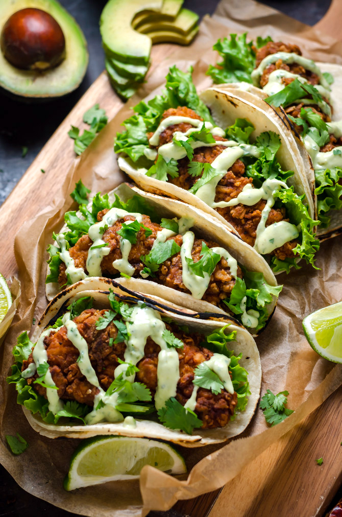 Crispy Chicken Tacos with Avocado Buttermilk Ranch. These tacos aren't traditional by any means, but they ARE delicious. Crispy, Mexican-seasoned chicken tenders + cool, creamy avocado ranch sauce are a match made in taco heaven. | hostthetoast.com