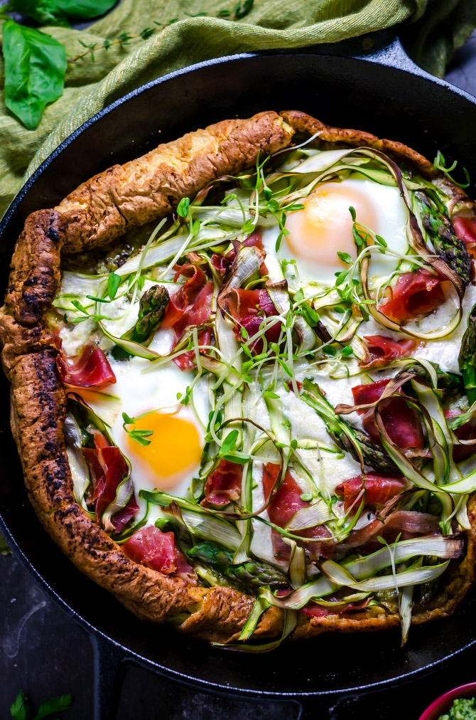 Dutch Baby Pesto Breakfast Pizza. This pancake-pizza hybrid is loaded up with herbs, prosciutto, shaved asparagus, burrata cheese, and eggs. Total brunch material. | hostthetoast.com