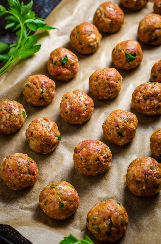 Slow Cooker Sticky Bacon & Whiskey Meatballs. These easy-to-make meatballs are smoky, sweet, and perfect for a party.   hostthetoast.com