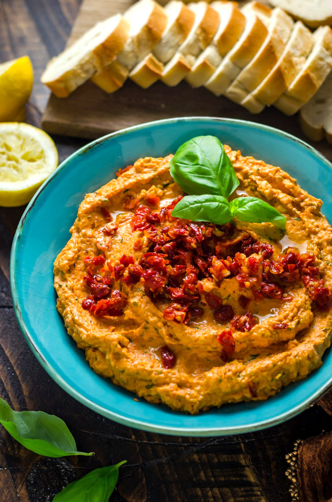 Creamy Sun Dried Tomato Basil Bean Dip. This white bean dip features cream cheese, sun dried tomatoes, lemon juice, fresh basil, and garlic, and comes together in minutes! It's the perfect spread for summer. | hostthetoast.com