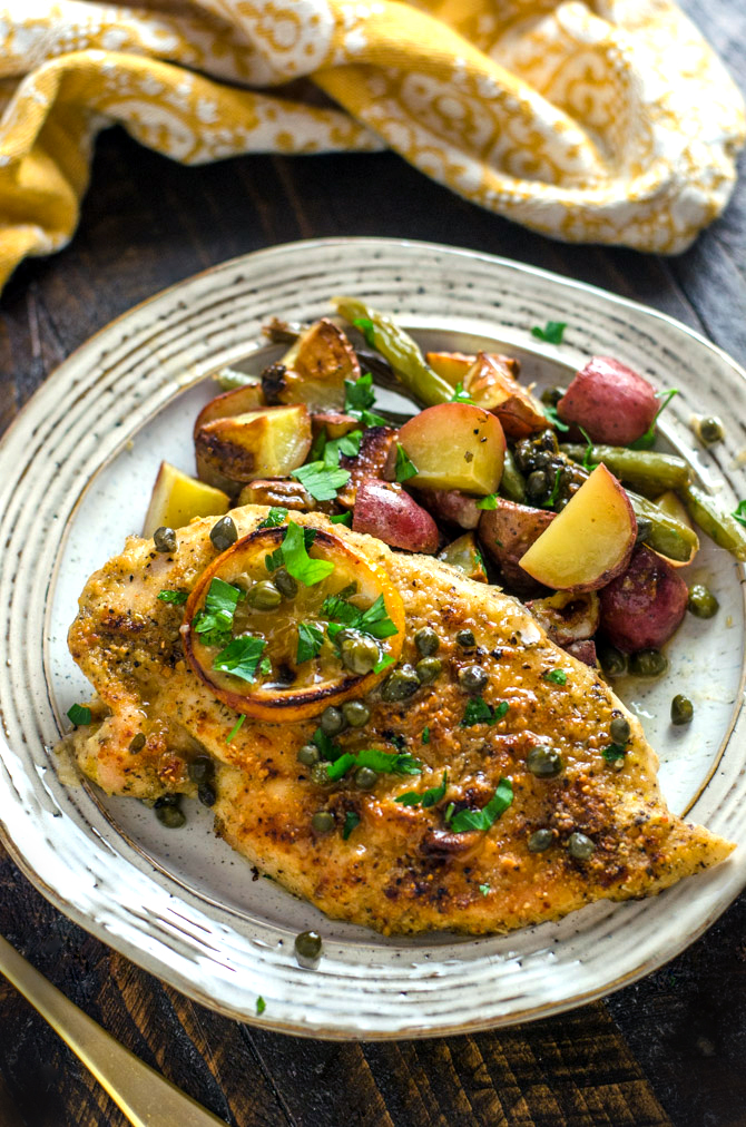 Sheet Pan Chicken Piccata with Roasted Potatoes and Green Beans. This easy, lemony one-pan recipe makes a great weeknight dinner. | hostthetoast.com