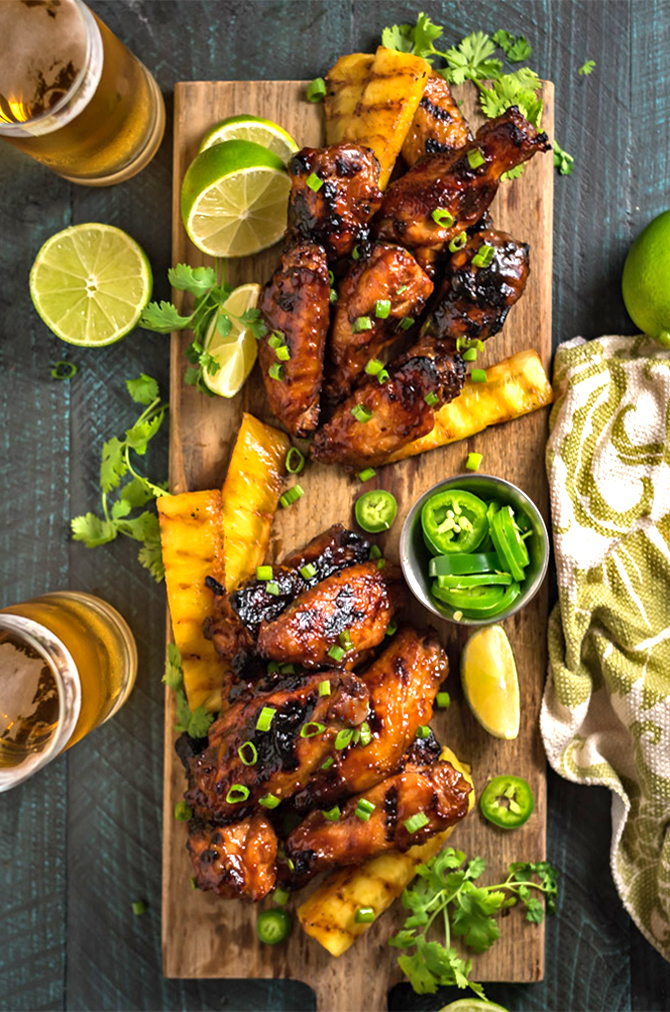 Hawaiian Huli Huli Grilled Chicken Wings. These island-inspired grilled wings are marinated and glazed with with sweet teriyaki flavors. Perfect for a cookout or game day tailgate.   hostthetoast.com