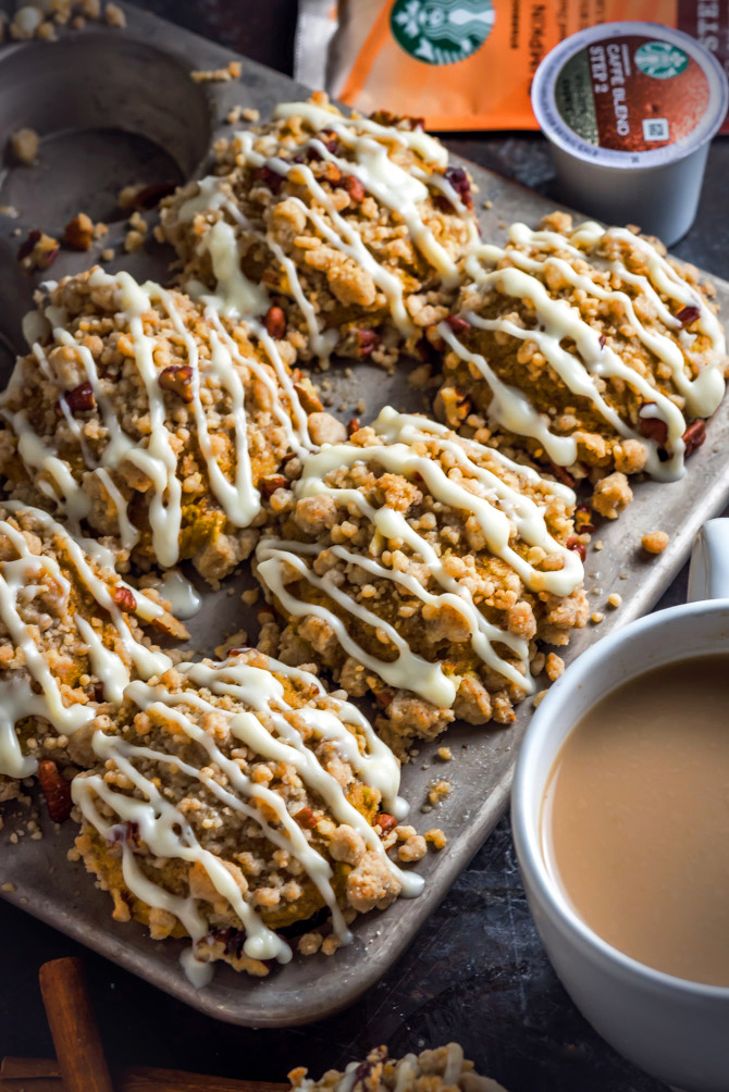 Pumpkin Crumb Muffins with Cream Cheese Glaze. If you love pumpkin spice, you're going to adore these moist and delicious muffins! They make for the perfect fall breakfast.   hostthetoast.com