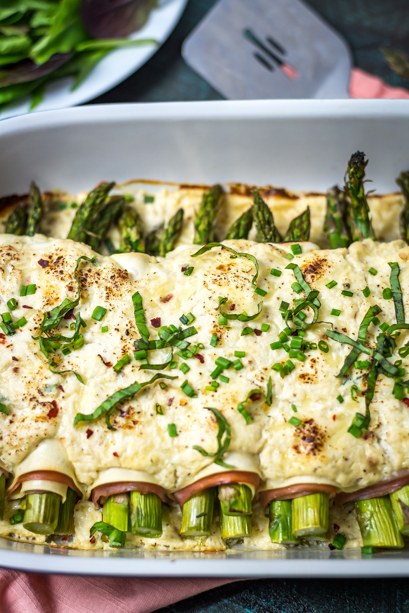 Cheesy Asparagus and Ham Cannelloni. An impressive dinner without a ton of effort. Lasagna sheets, deli-sliced ham, fresh asparagus, and a simple 3-cheese sauce come together to make a truly special dish for the family. | hostthetoast.com