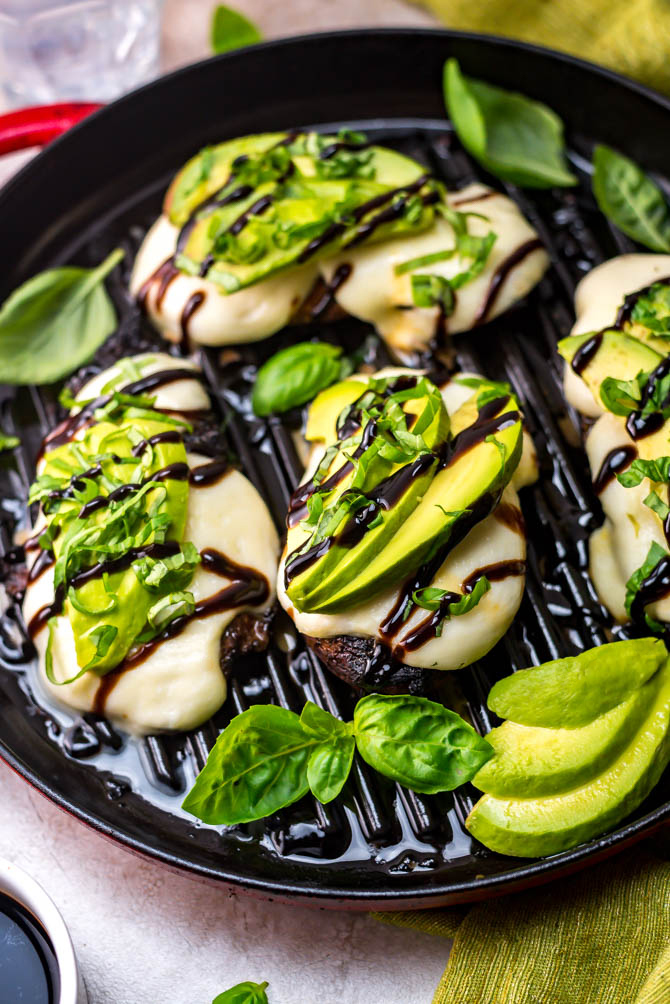Grilled Avocado Balsamic Chicken. A sweet and tart balsamic vinegar marinade, melted mozzarella cheese, tender grilled chicken, creamy avocado, fresh basil, and a balsamic drizzle come together to create a delicious, easy-to-make dinner. | hostthetoast.com