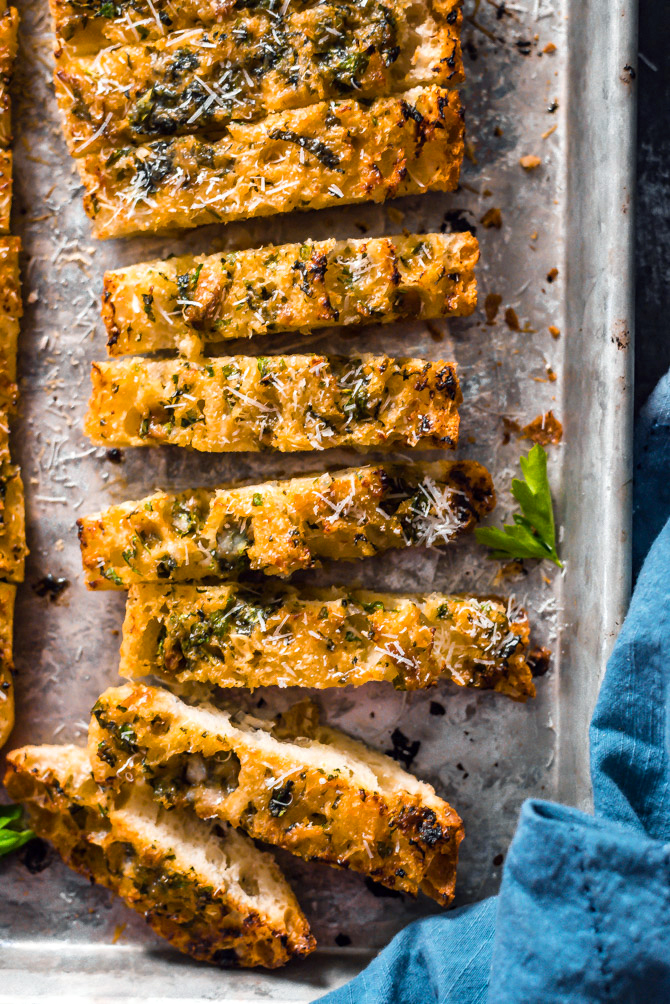 Caramelized Onion and Garlic Bread. A sweet garlic-onion-herb butter is smeared over spongy ciabatta, hit with plenty of parmesan, and baked until beautifully browned. | hostthetoast.com