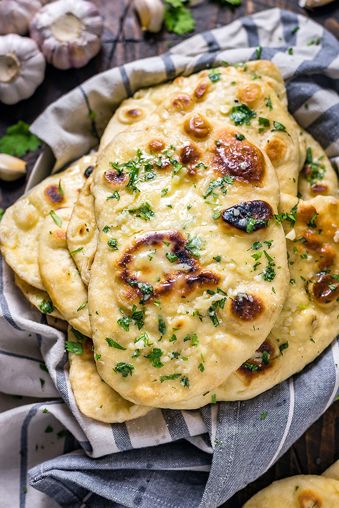 This Homemade Garlic Naan recipe is truly the best. Even if you've never made bread at home before, this soft, chewy, garlicky flatbread is easy to make and well worth the effort. You're going to love serving it with your favorite Indian dishes.