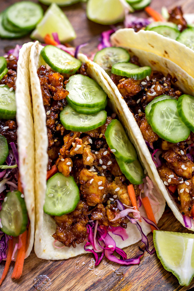 Korean-Inspired Crispy Tofu Tacos on a wooden cutting board.