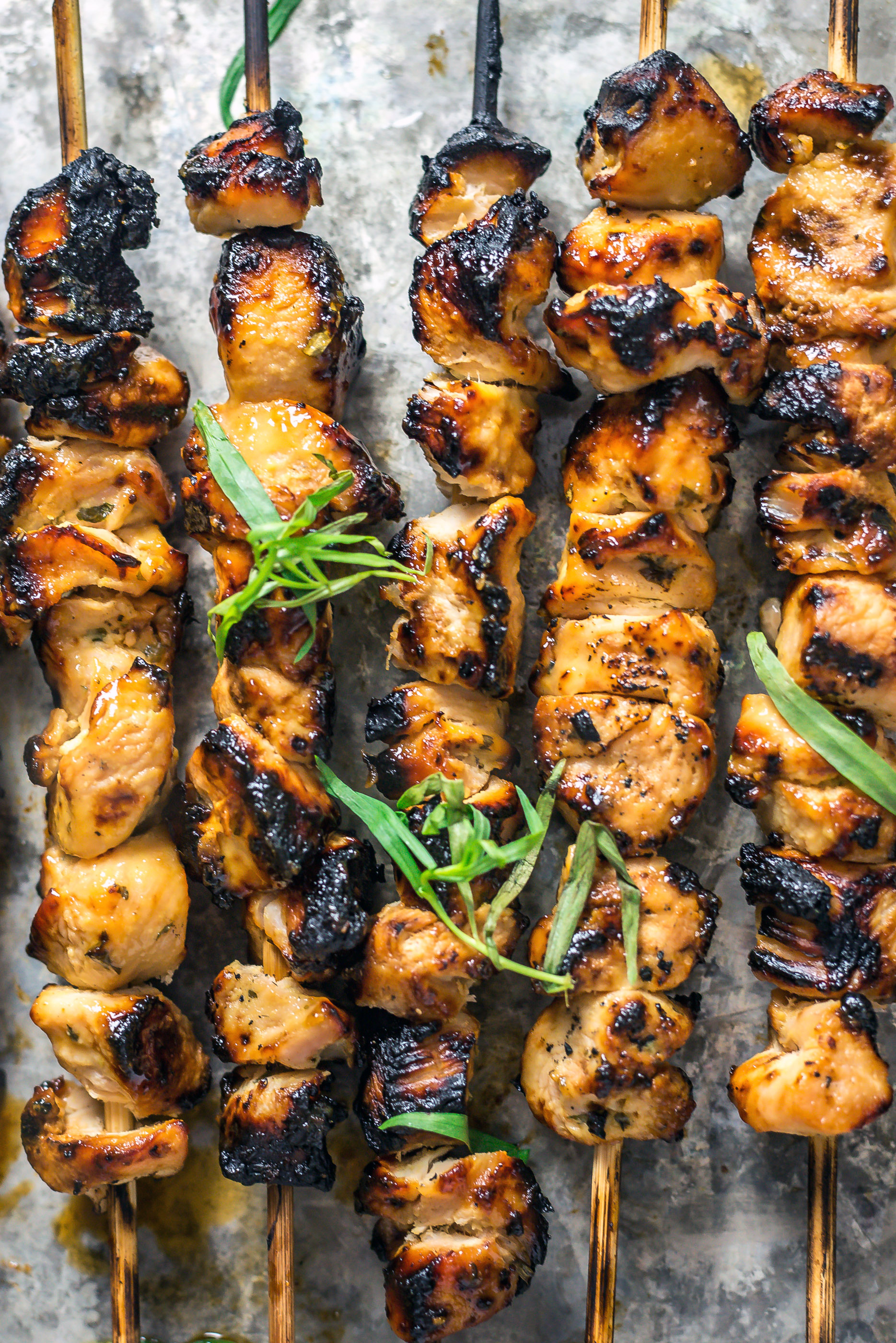 Close up view of lightly charred Tarragon Mustard Chicken Skewers