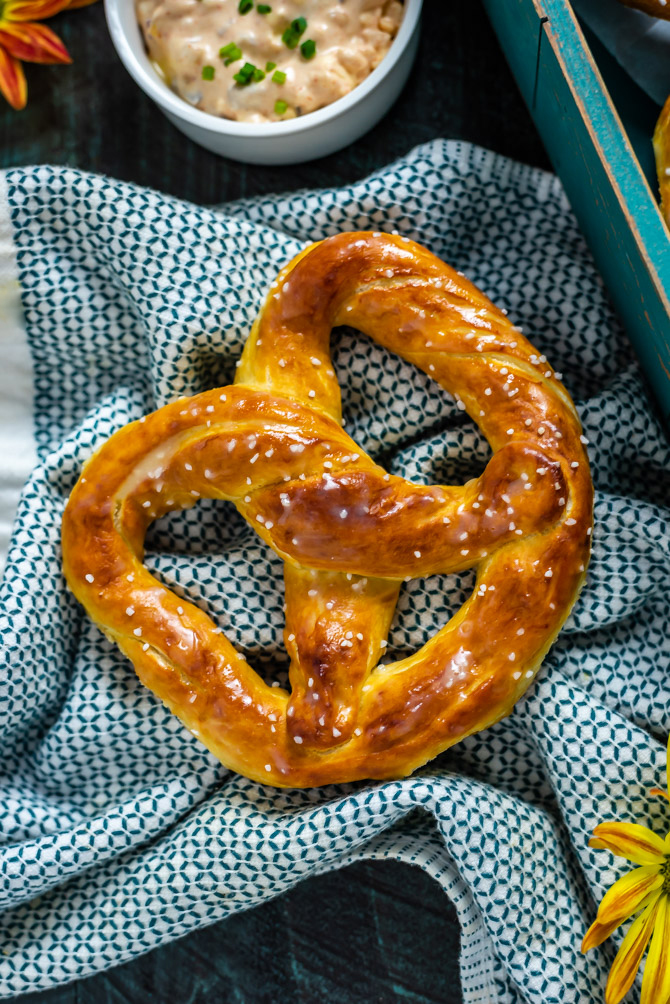 An overhead close up view of a single Homemade Mall-Style Soft Pretzel.
