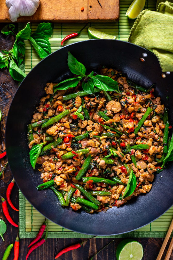 A close up overhead view of 15 Minute Thai Basil Chicken in a large wok.