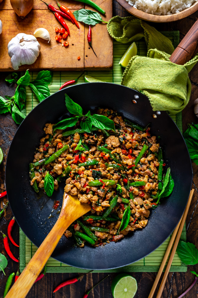 15 Minute Thai Basil Chicken in a large wok with a wooden spoon.