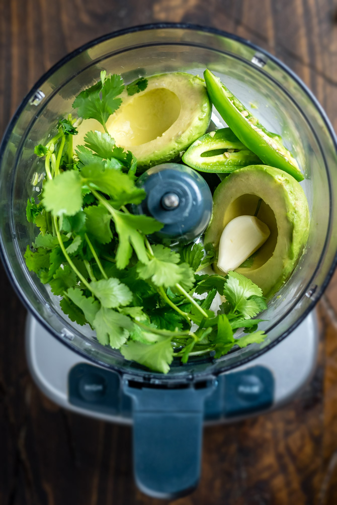 This Dreamy, Creamy Avocado Cilantro Sauce takes just5 minutes to makeandis perfect for serving on tacos, over salads, with sweet potatoes, or simply with a side of chips for dipping. Let's be honest, you're going to eat it on everything. | hostthetoast.com