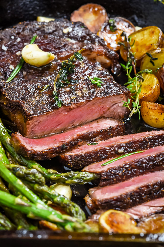 Pan-Fried Garlic Butter Steak with Crispy Potatoes and Asparagus. Meet the equally simple and sexy date night meal that will change the way you tackle romantic dinners forever. The key? A high heat sear on the steak and lots of basting with garlicky herb butter to finish off the cooking process. | hostthetoast.com