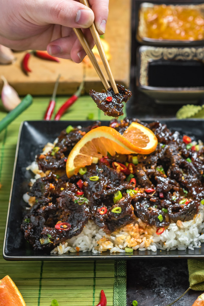 Spicy, Crispy Orange Beef. This version of the Chinese takeout classic features thin slices of crisp sirloin steak that are tossed in a spicy, sweet, and savory orange sauce. You can make it at home in less time than it takes to get delivery. (And it'll taste better, too!) | hostthetoast.com