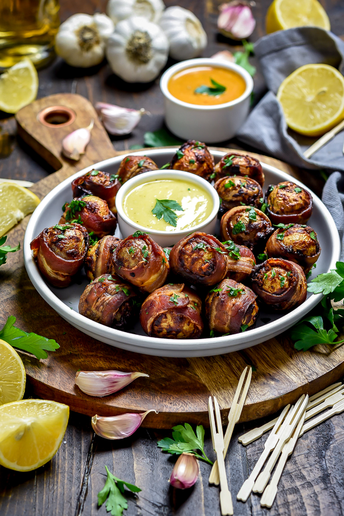 Tender and fluffy on the inside with crisp bacon and a smoky seasoning mix on the outside, Smoky Bacon-Wrapped Baby Potatoes as easy to make as they are to devour. While this recipe technicallyfeeds six, you'll find these addictive one-bite-wonders are best-served in bulk. | hostthetoast.com