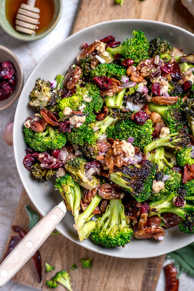 Seared (but still crisp) broccoli forms the flavorful base of this Charred Broccoli Salad with Hot Honey Dressing. With toasted pecans, sharp red onion, crisp bacon, tangy goat cheese, dried cranberries, and a sweet-and-slightly-spicyhomemade hot honey dressing, this side dish has a little bit of everything for your cookout, dinner party, or lunch box.   hostthetoast.com
