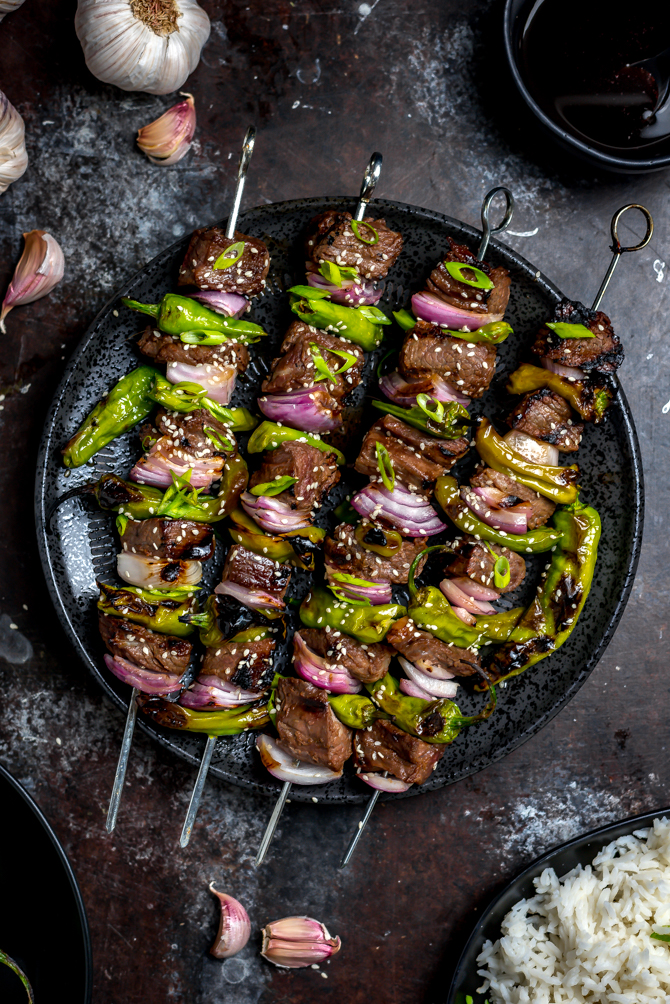 There's more to these Asian Steak and Shishito Skewers than meets the eye. The sweet and garlicky marinated steak will be love at first bite, while the rare spicy surprise of a hot shishito keeps you coming back for more. | hostthetoast.com