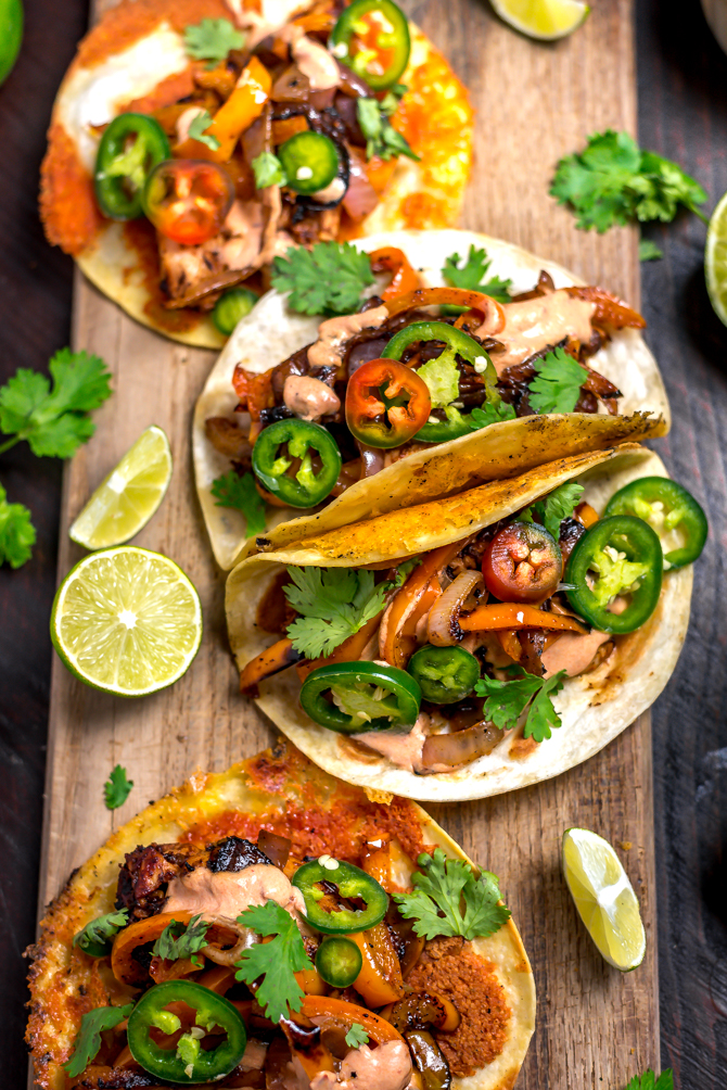 With classic fajita ingredients piled high in crispy cheddar-adorned tortillas and finished with a 3-ingredient chipotle crema, this recipe is bound to be your new Tex-Mex favorite. Crispy Cheddar Chipotle Chicken Fajitas make for an easy, flavor-packed, and picky-eater-approved weeknight dinner.   hostthetoast.com