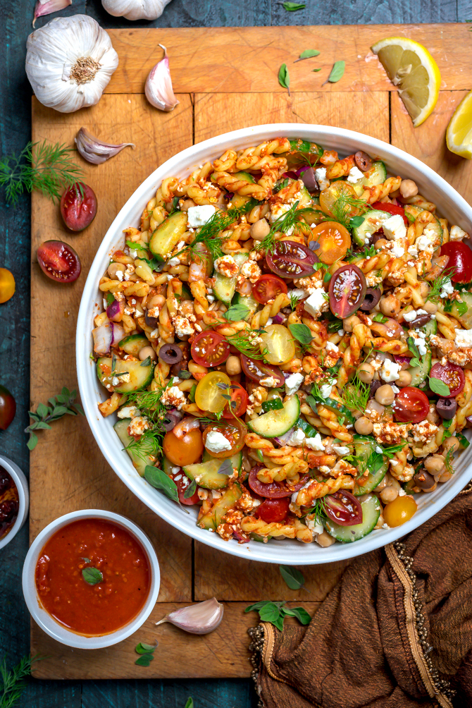 This super easy-to-make summer side dish beats store-bought pasta salad any day. Loaded up with Mediterranean flavors, Greek Pasta Salad with Sun Dried Tomato Vinaigrette is bright, zesty, and delightfully briney.   hostthetoast.com