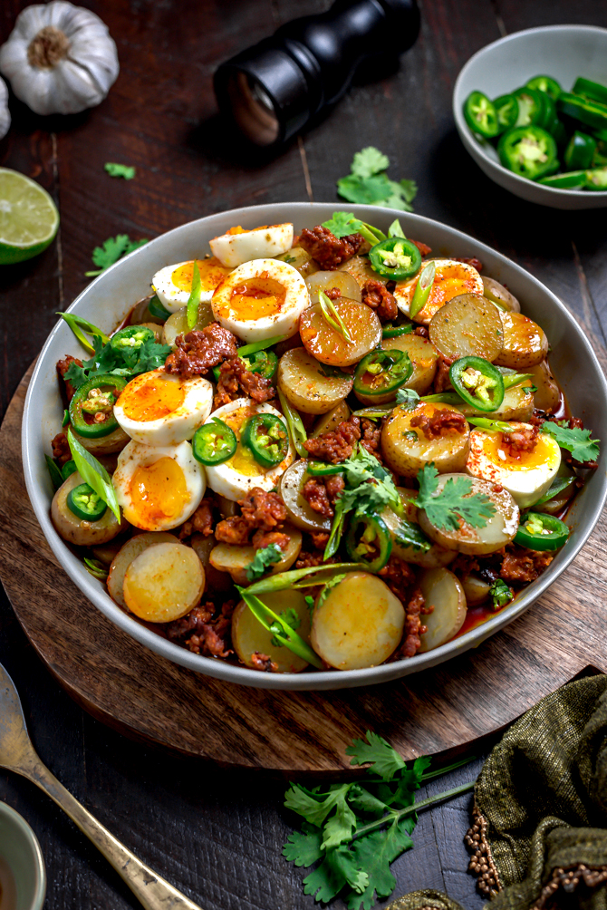 With a whisper of smoke and spice, Warm Chorizo Potato Salad is a Mexican-inspired spin on the German classic. Served with soft-boiled eggs and a chorizo vinaigrette, this mayo-free mash-up is best served warm.    hostthetoast.com
