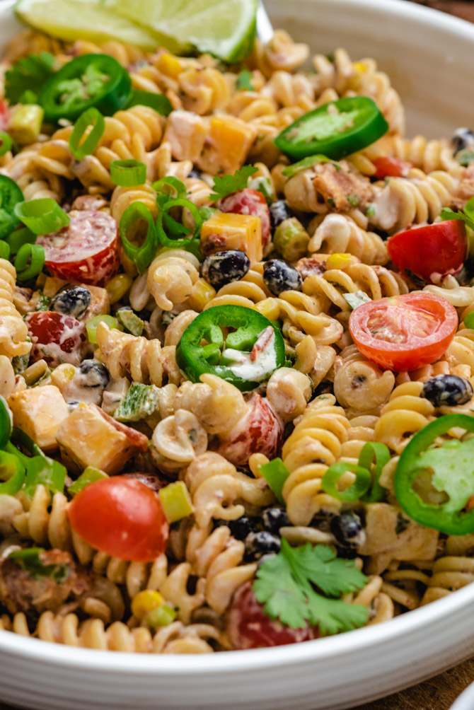 This zesty Southwestern Pasta Salad features all the best and boldest fixings. Bacon, jalapeños, black beans, corn, and more are dressed in a creamy chipotle ranch dressing that will have your whole party lining up for second helpings.