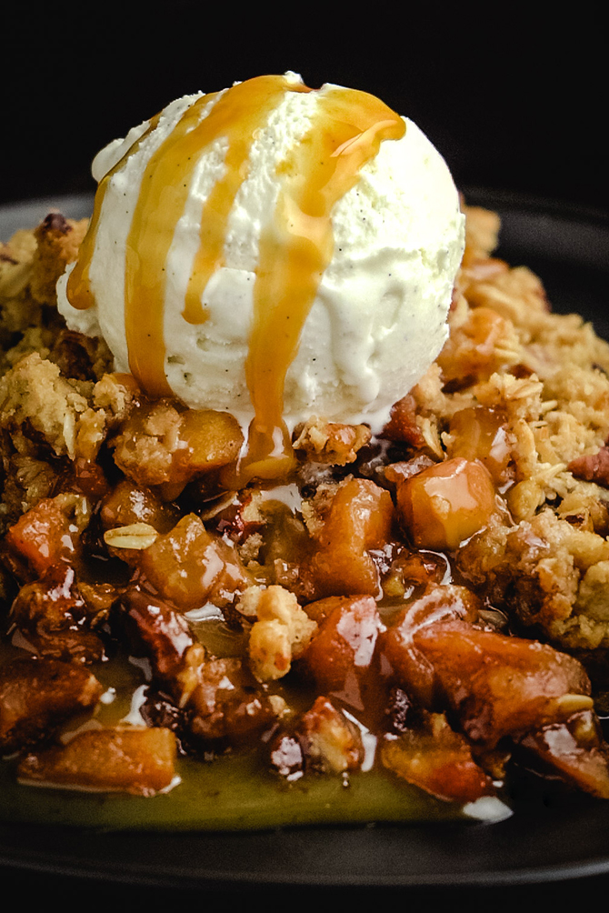 This Caramel Apple Crisp has it all: tender baked apples, easy homemade caramel, and a flavor-packed oat streusel topping! It pulls out all the (super flavorful) stops and still requires just a fraction of the time and effort of traditional apple pie.