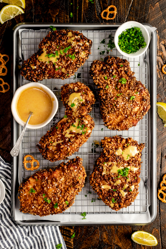Pretzel crumbs are the key to crispy, crunchy chicken cutlets that everyone will love. The homemade honey mustard sauce makes this Pretzel Crusted Chicken recipe even tastier.
