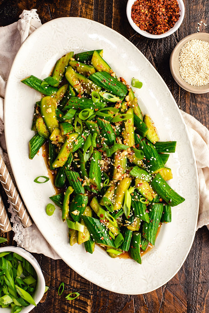 Cool cucumbers, hot chili flakes, and a generous amount of garlic are just a few of the ingredients that make this flavor-forward, Asian-style cucumber salad so good. It's the perfect refreshing side dish or big-hit potluck salad.